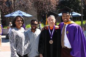 Izaiah Hakim Wallace & family are congratulated by Dr. Sahakian