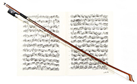 Cello bow with sheet music