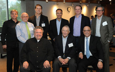Front (left to right): Bruce Mau, Gordon Segal, Julio M. Ottino. Back: Mark Dziersk, Walter Herbst, event co-chars Geoff Cubit and Tim Stojka, Pat Ryan Jr., and Nick Kokonas.