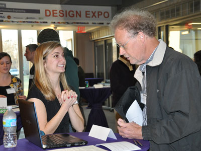 Senior Allison Bedell presents her portfolio at the Segal Design Institute's first annual Design Expo