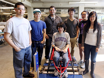 Students in Design Thinking and Communication (formerly Engineering Design and Communication) show off their project, a treadmill for wheelchair athletes