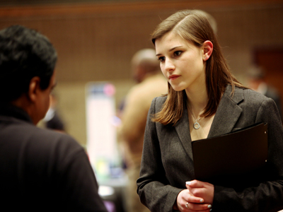 A student talks to a recruiter at a Northwestern career fair.