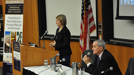 Ann Schneider and William O. Lipinski address the crowd at the Lipinski Symposium on Transportation Policy & Strategy.