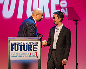 McCormick senior Dennis Ai is congratulated by Newark Mayor Corey Booker after winning the End Childhood Obesity Innovation Challenge.