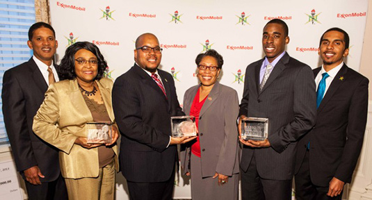The National Society of Black Engineers (NSBE) and ExxonMobil honored three universities with the 2013 Impact Award. Pictured left to right: Kenny Warren, ExxonMobil; Minnie McGee, Ohio State University; Antoine Baines, University of Michigan; Congresswoman Marcia Fudge, U.S. House of Representatives - Ohio; Andy Nwaelele, vice president of Northwestern's NSBE chapter; and Calvin Young of NSBE.