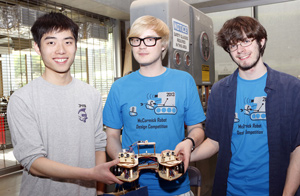 "First-place winners ""Aperture Robotics,"" with team members (left to right) Kevin Ye, Georgiy Mazin, and Seth McCammon"