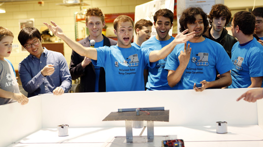 Students watch as their robots battle at the 2013 Design Competition.