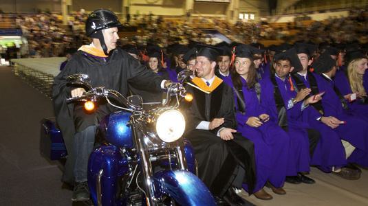 President and chief operating officer of Harley-Davidson Motor Company Matt Levatich (MMM '94) rides in during the McCormick undergraduate commencement on June 22.