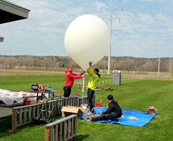 The students ready the weather balloon for a launch.