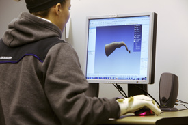 Lauren Tyndall designs a new hand splint in the the Rapidform program.