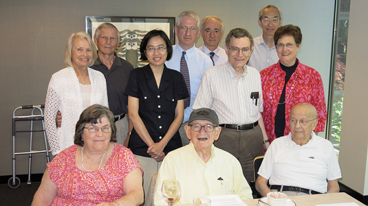 Morris Brodwin (center), emeritus professor of electrical engineering and computer science, is recognized at a luncheon on July 14.