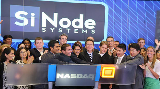 Members of the clean tech startup SiNode Systems ring the closing bell at NASDAQ on August 23.