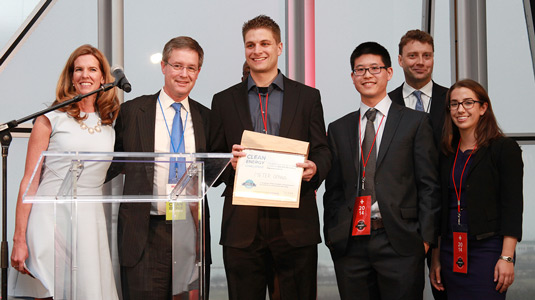 MeterGenius' Ty Benefiel (center) holds a certificate, which awards the company the $25,000 McCaffrey Interest Prize at the Midwest Regional Clean Energy Challenge. MeterGenius members Yan Man and Hillary Hass (both standing on the right) accept the prize with him.