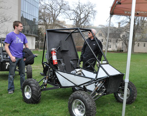 A crowd, including President Morton Schapiro, checks out the 2014 Baja SAE car during its April 24 unveiling.