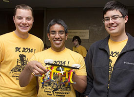 Members of Team Jankbot Rises (from left: Stefan Hyde, Nikhil Holay, and Jorge Solis) show off their winning design.