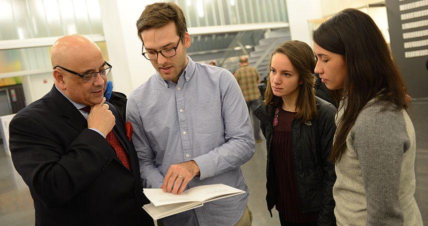 Northwestern students Brandon Williams, Steph Shapiro, and Olivia Ching explain their project to Dean Ottino.