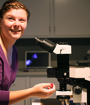 Emilie Campbell examines artwork under a Raman microscope.