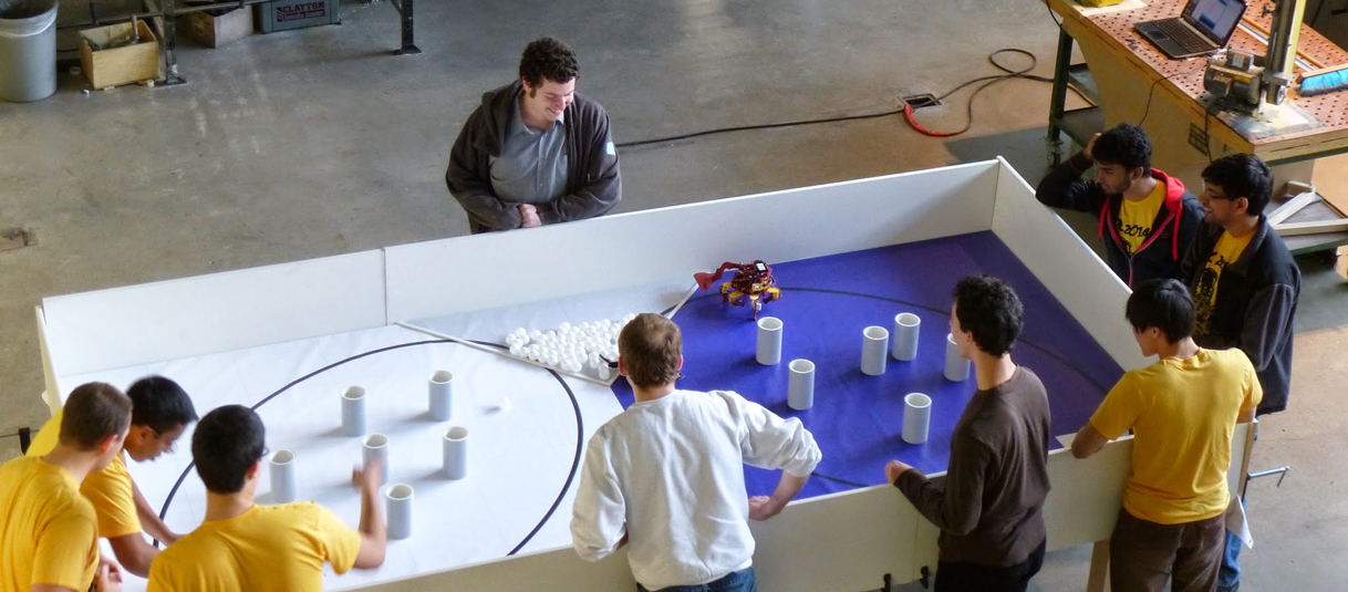 A crowd watches as an autonomous robot attempts to pick up Ping-Pong balls during last year's Design Competition.