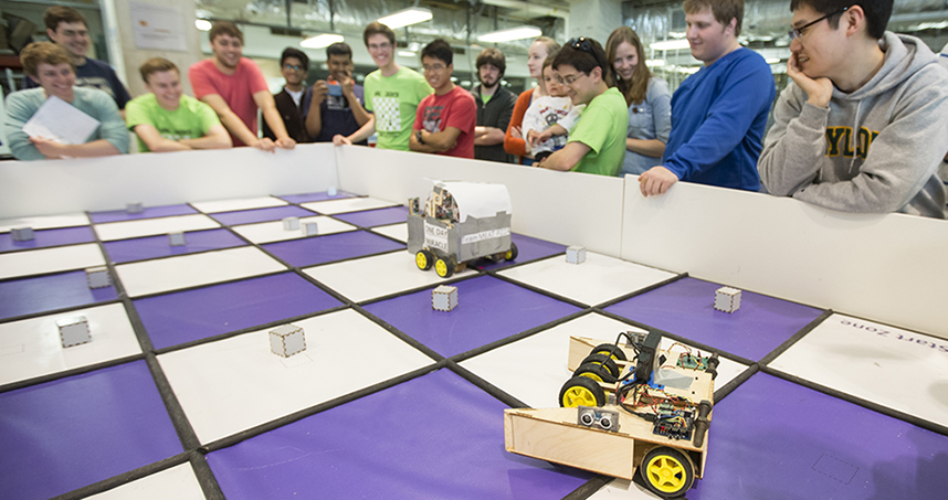 Students watch as Veggie Bot competes in Robot Checkers.