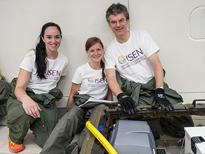 Kristen Scotti, Emily Northard, and David Dunand sit with their freeze-casting equipment during their first flight on the Weightless Wonder.