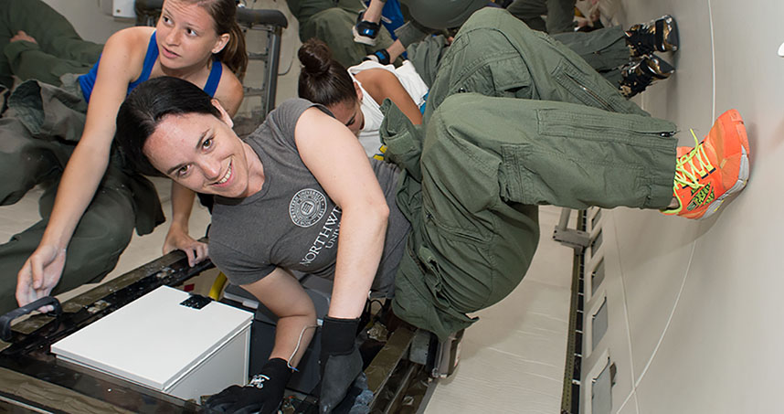 Undergraduates Kristen Scotti (foreground) and Emily Northard defy gravity during their first trip with NASA.
