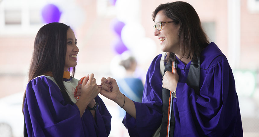 Friends celebrate their graduation after McCormick's commencement ceremony