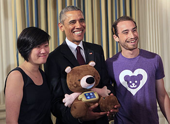 Sproutel co-founders and DFA alumni Hannah Chung and Aaron Horowitz presented Jerry the Bear to President Barack Obama during the first-ever White House Demo Day in 2015.