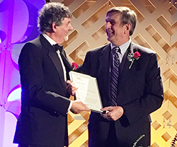 Wessels (right) receives the award from Patrice Turchi, TMS president.