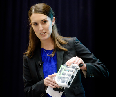 Ampér's Carolyn Snider presents a prototype of the team's smart circuit breaker.