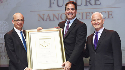 Chad Mirkin (center) accepts the 2016 Dan David Prize in the Future Time Dimension from Joseph Klafter (left), president of Tel Aviv University and chairman of the Dan David Prize Board of Directors. Northwestern President Morton Schapiro (right), also attended. Photo by Hadari Photography.