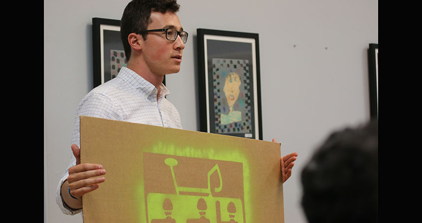 Charles Tokowitz presents his bike safety signs to Evanston officials. Credit: Evanston Now