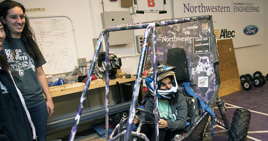 Members of Northwestern's Baja team tell participants about the process of building a car.