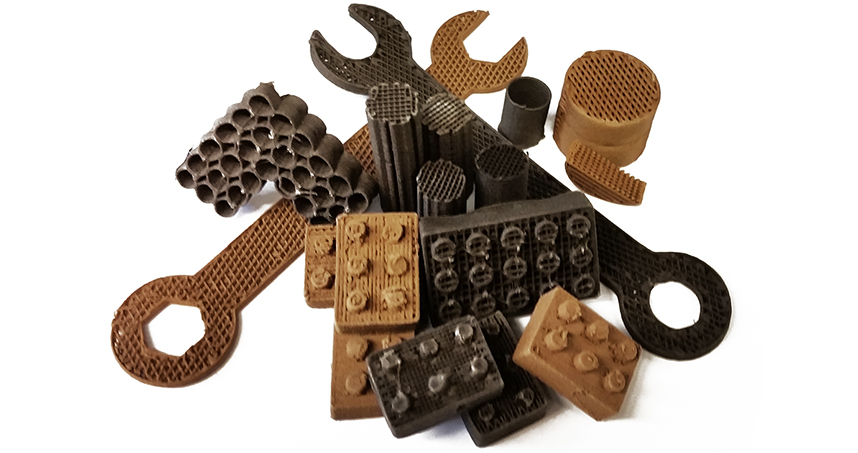 Tools and building blocks made by 3D printing with lunar and Martian dust.
