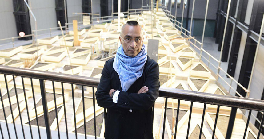 "Cruzvillegas stands in front of ""Empty Lot"" at the Tate Modern"