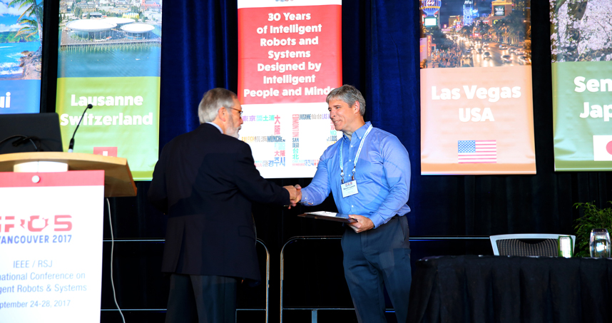 Kevin Lynch accepts the the 2017 IROS Harashima Award for Innovative Technologies.