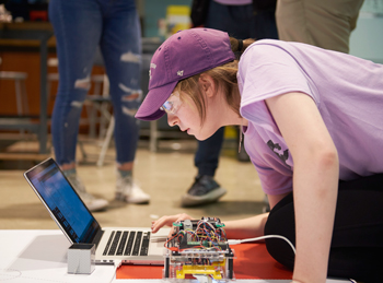 A student gets her robot ready for competition.