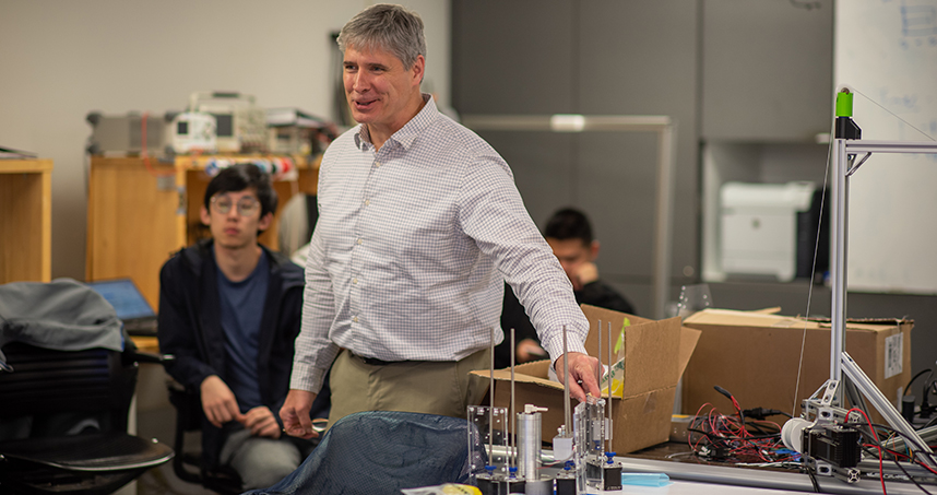 Kevin Lynch, chair of mechanical engineering, consulted with students about their robot project. Credit: Rob Hart