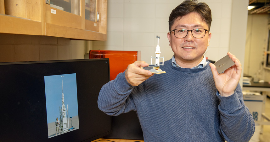 Ken Park holds a Lego model of a moisture vaporator from Star Wars, which inspired his research in fog harvesting.