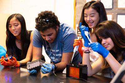 High school students use the BioBits educational kit.