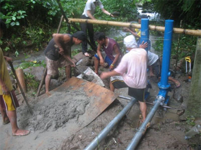 ESW members working on the pump